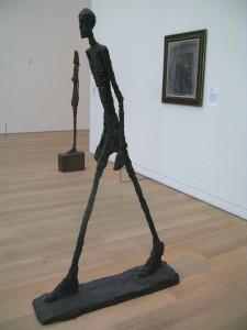 statue of walking man